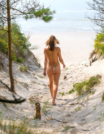 Natural nude girls together beach